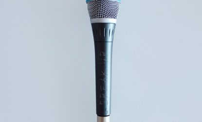 microphone with speak up written on it